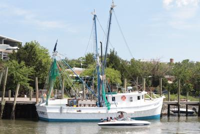 Shrimp boat and small boat.jpg