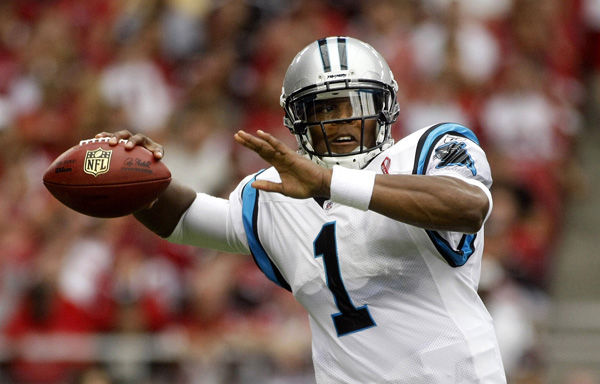 Panthers fall, but Carolina quarterback Newton shines with record-setting debut