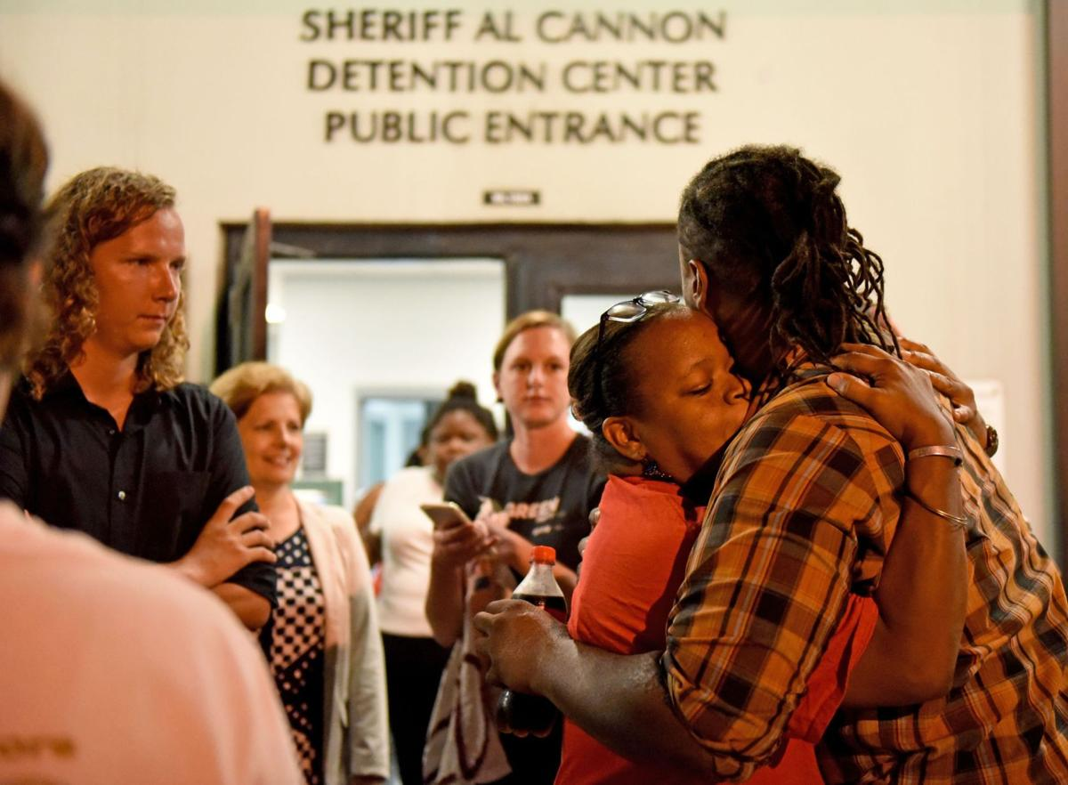 Activist removed from meeting, charged with disorderly conduct