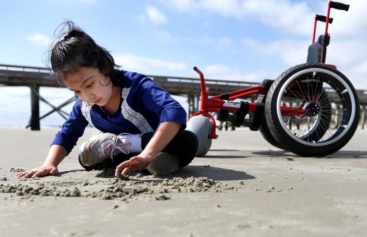 Children diagnosed with spina bifida receive beach wheelchairs ...