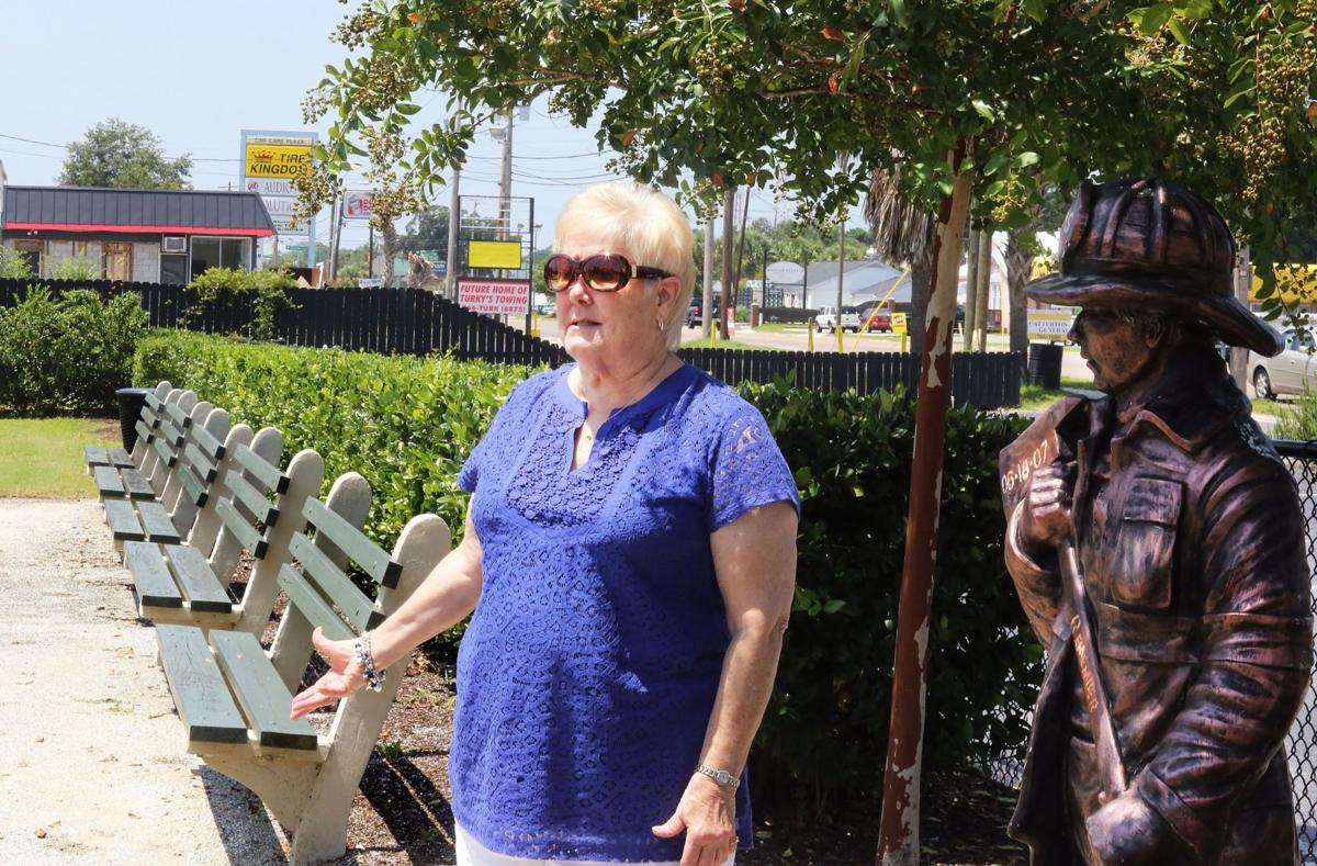 Dead firefighter's mother questions allowing 'junkyard' next to Sofa Super Store memorial