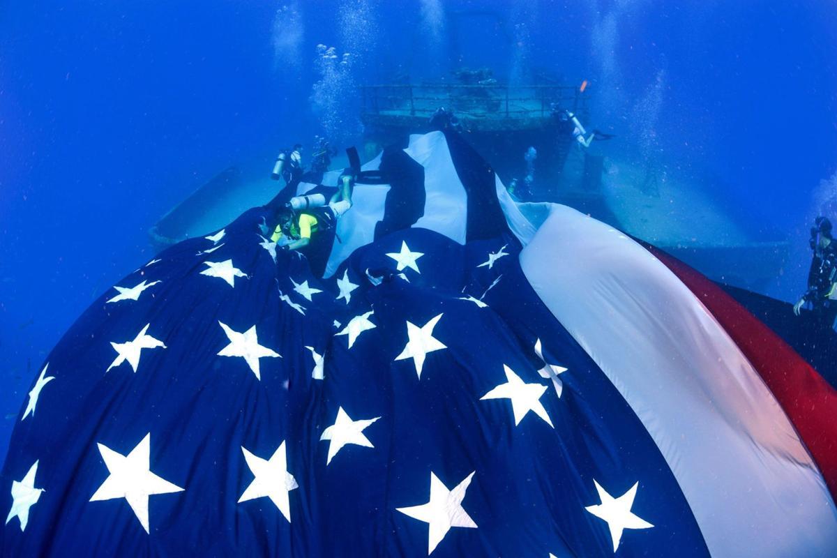 Divers unfurl US flag at shipwreck near Fla. Keys