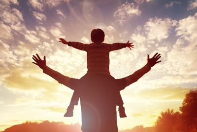father-son-sunset-dreamstime (copy)
