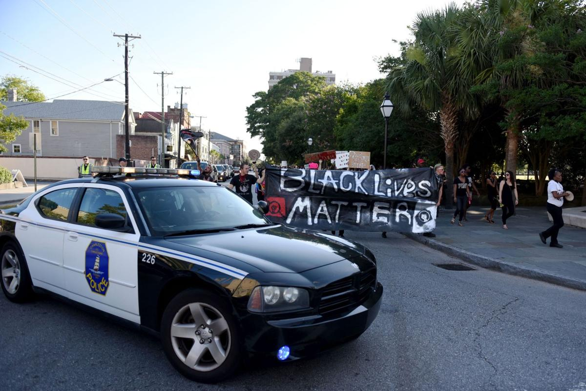 'They're throwing bricks!' Charleston's impromptu street protest sparked tense police response