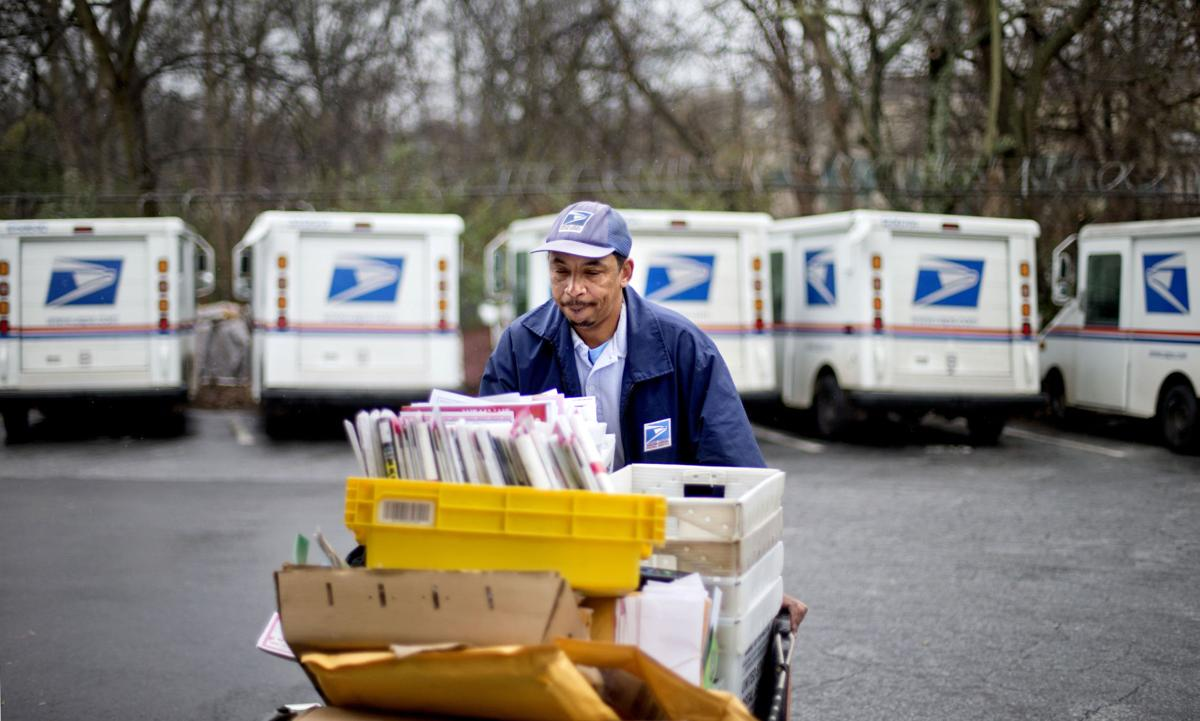 US Postal Service loses $2B this spring