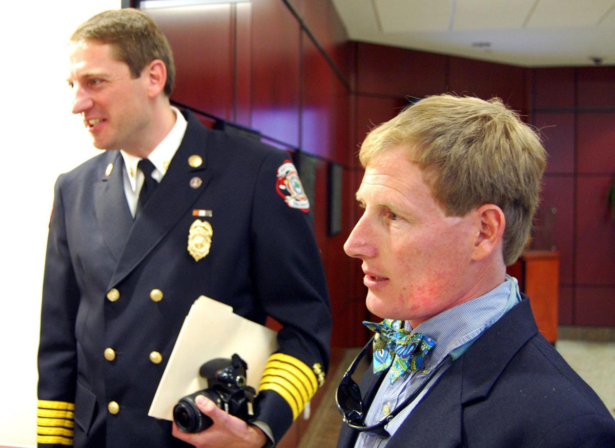 Officer, two men hailed as heroes for saving lives