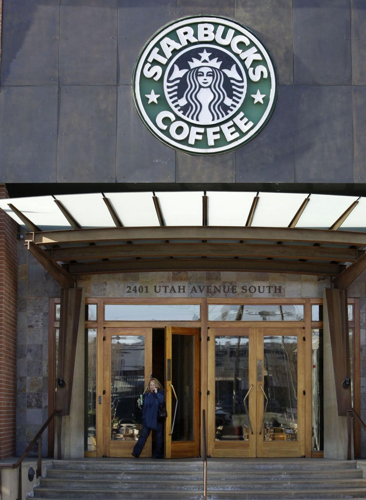 Starbucks' progressive ways draw fire on guns