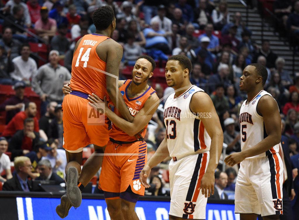 3982f6ebbb6 NCAA Clemson Auburn Basketball. Clemson forward Elijah Thomas (14)  celebrates a basket ...