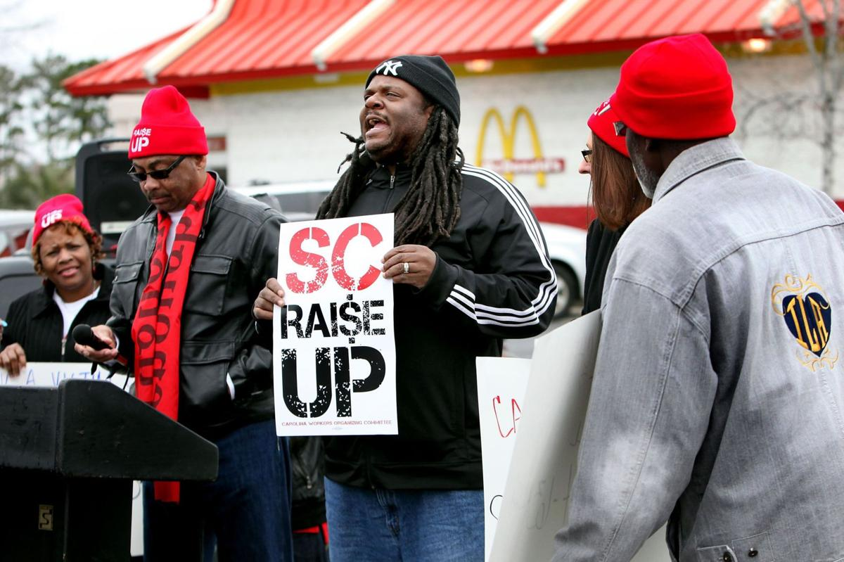Local fast-food protest shows support for 'wage theft' lawsuit Fast-food workers hungry for raise Locals add voices to national protest