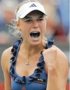 No. 1 Wozniacki struggles into next round as top seeds fall