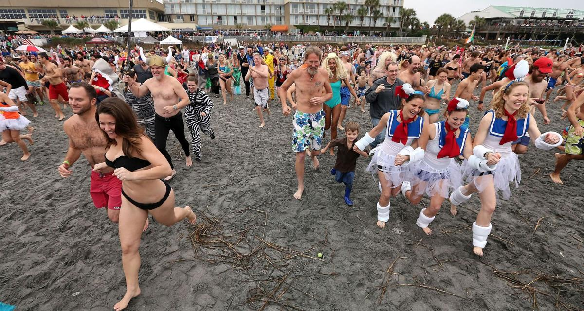 Crowds linger in warm seas at polar plunges