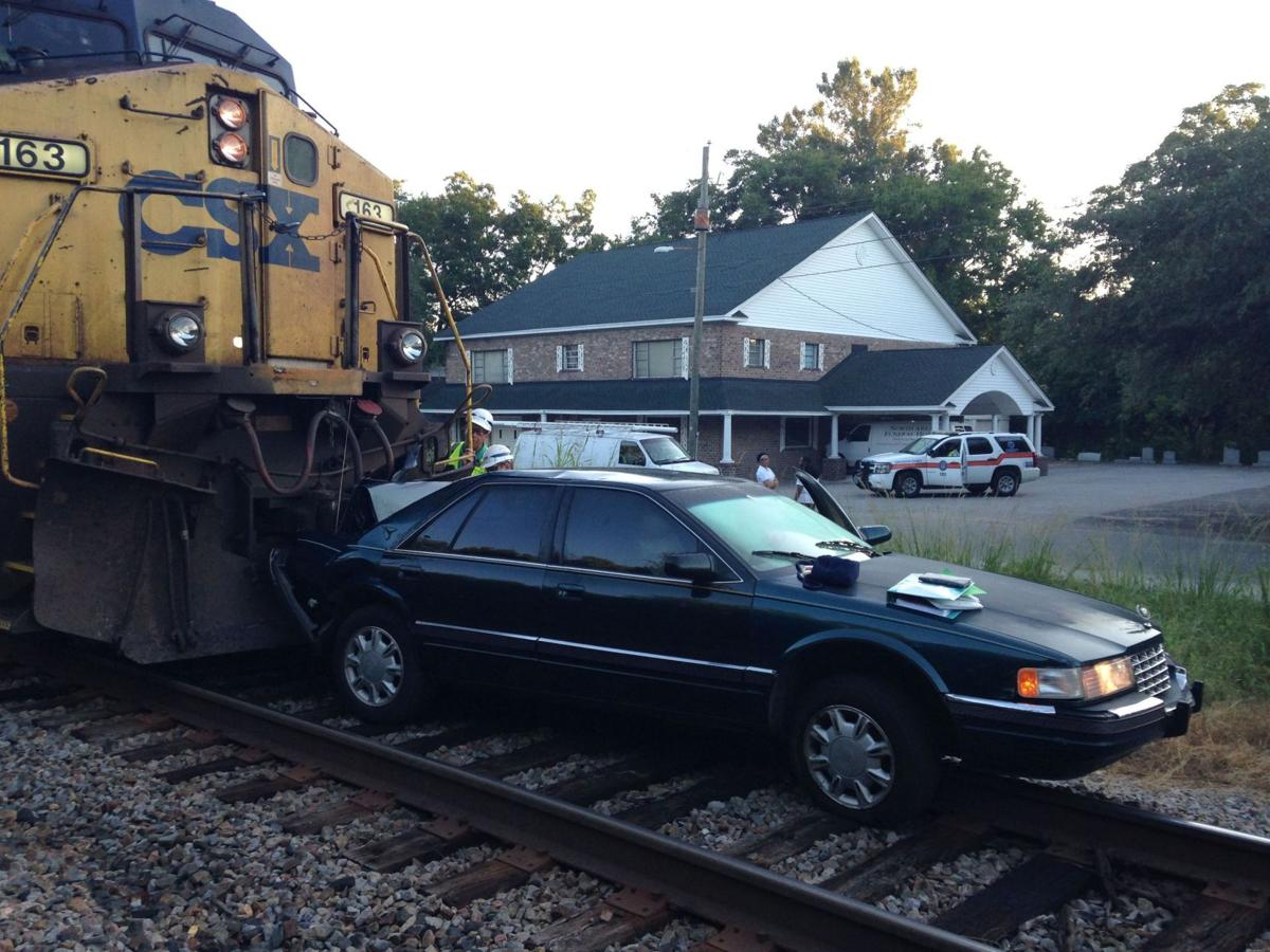 North Charleston police ticket driver after train hits car stuck on railroad tracks