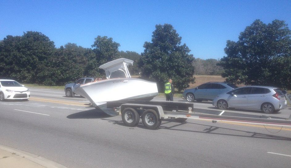 Boat in the road slows Folly Road traffic