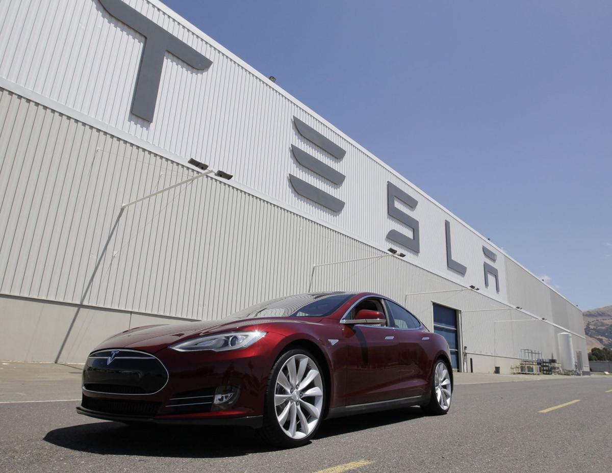 Tesla says car fire began in battery after crash