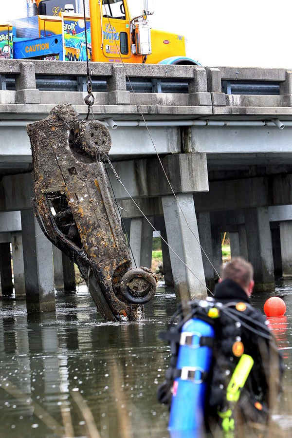 Soggy wheels: Vehicles pulled from river