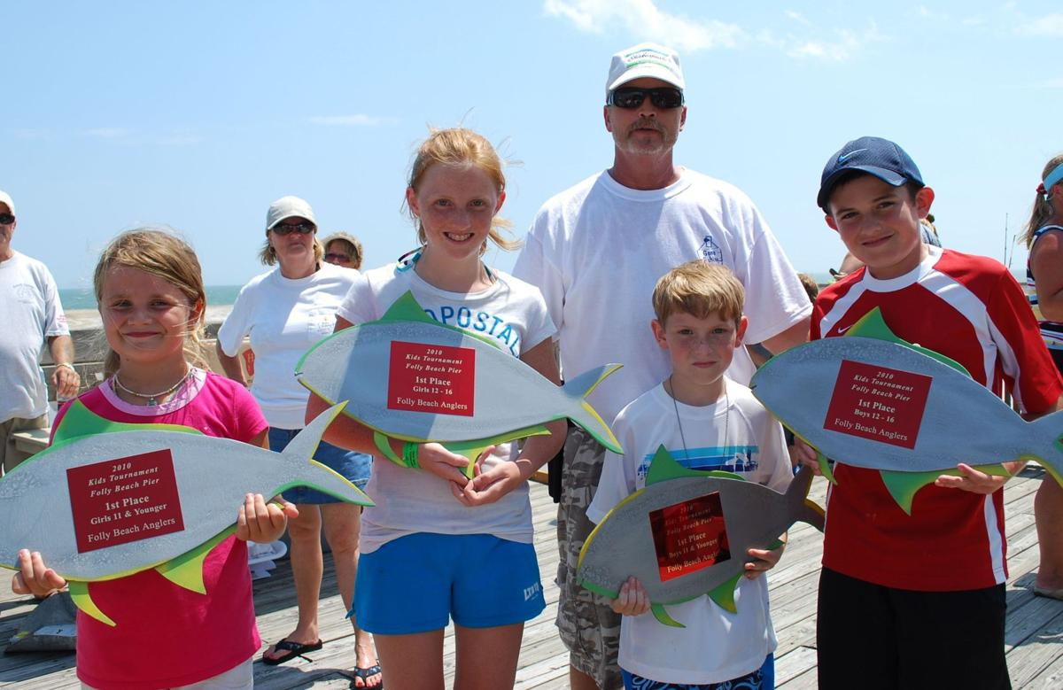 Folly Beach Anglers teaching kids how to fish at Folly Pier