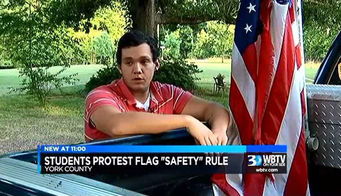 Dozens protest student having to remove flag from pickup