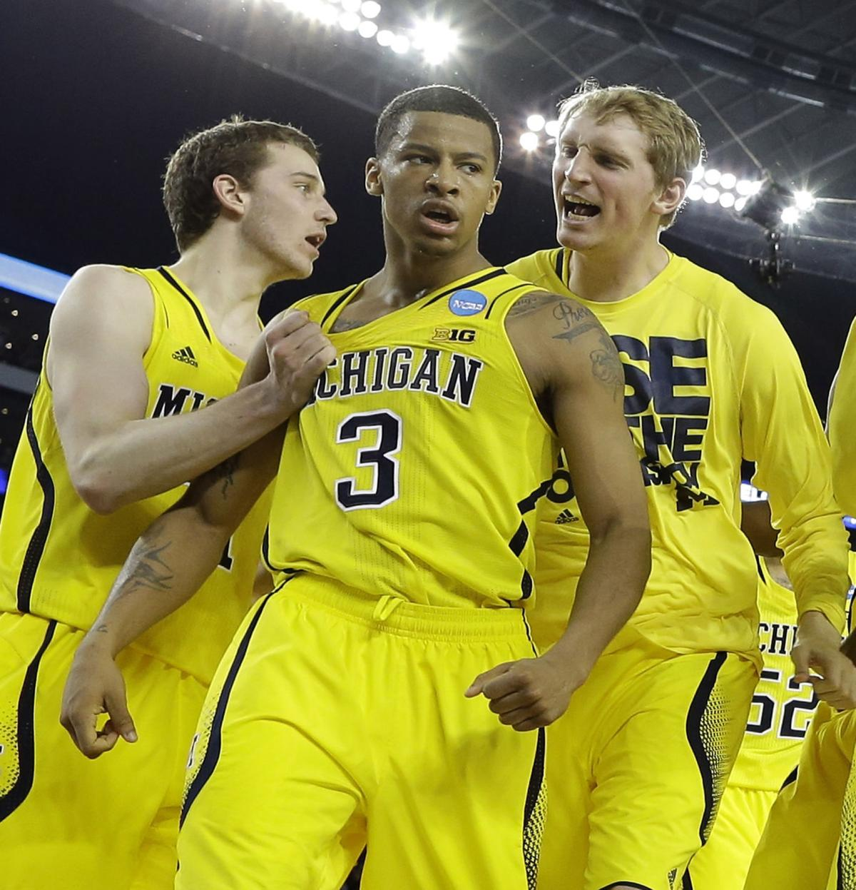 Burke leads Michigan rally over Kansas, 87-85 in OT