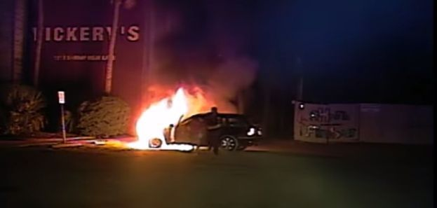 Dramatic video: Mount Pleasant police officer pulls man from burning car