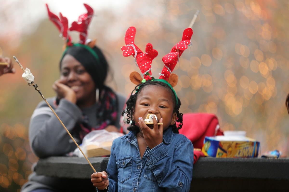Reindeer girl eating s'mores at parade