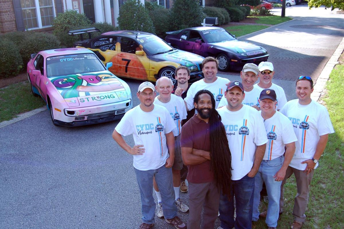 Driving for victims Volunteers, at-risk youth prep older Porsches to race as tribute to Emanuel 9