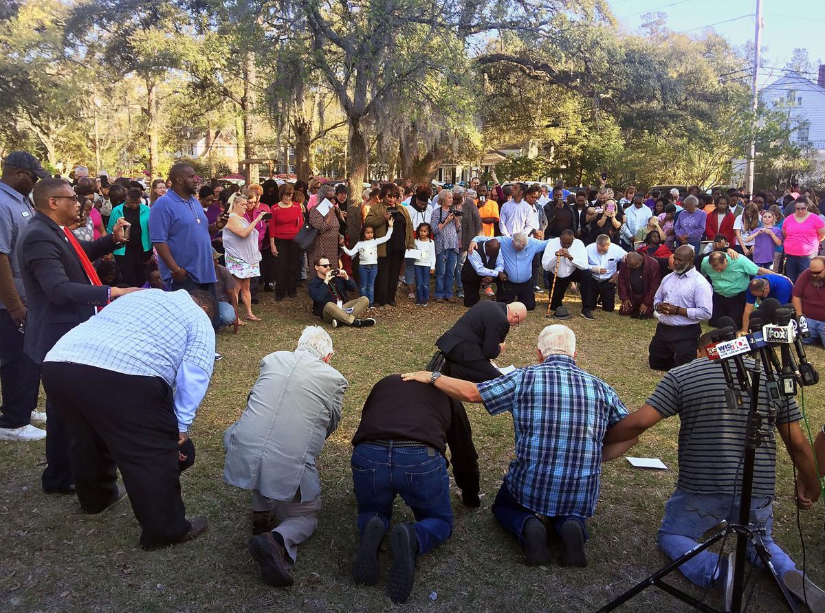 kneeling pastors prayer vigil by greg yee.jpg