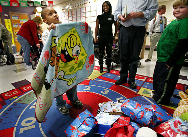 Drayton Hall 2nd-graders collect presents, money for toddler