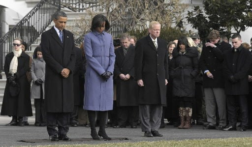 Obama leads moment of silence for shooting victims