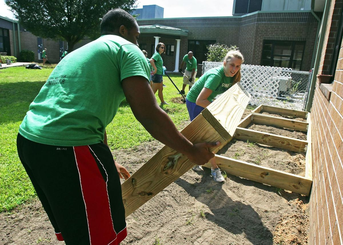 Record Day of Caring Estimated 8,500 volunteers pitch in on community projects