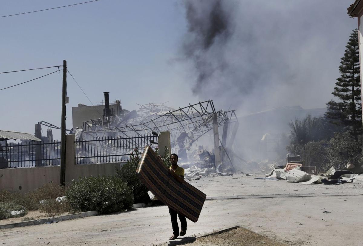 Israel hits symbols of Hamas rule; scores killed