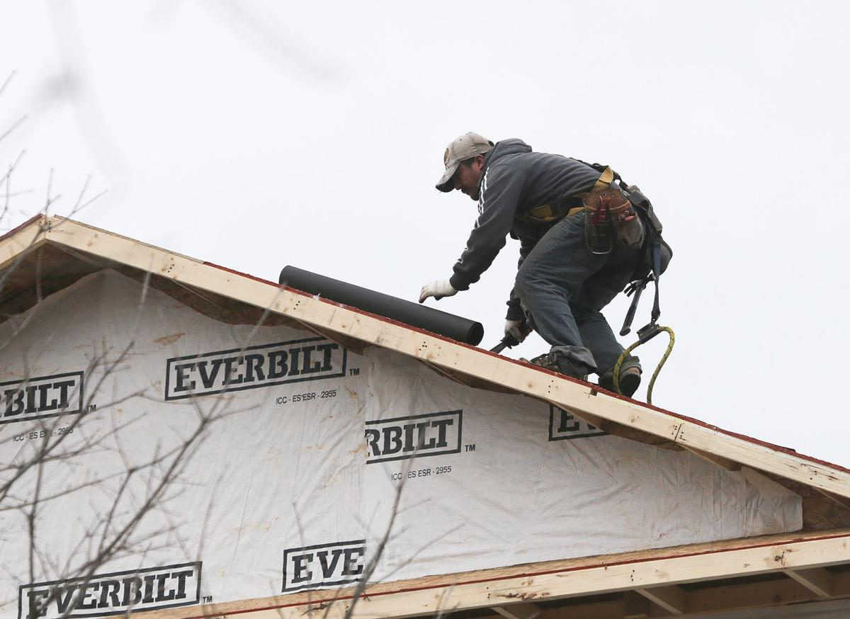 US housing starts fall in cold, snowy Jan.