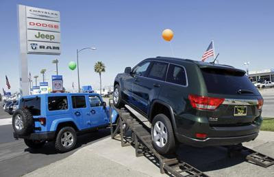 Carmakers report surprising sales