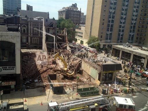 Philadelphia building collapses, crews working to extricate 2 people from the rubble