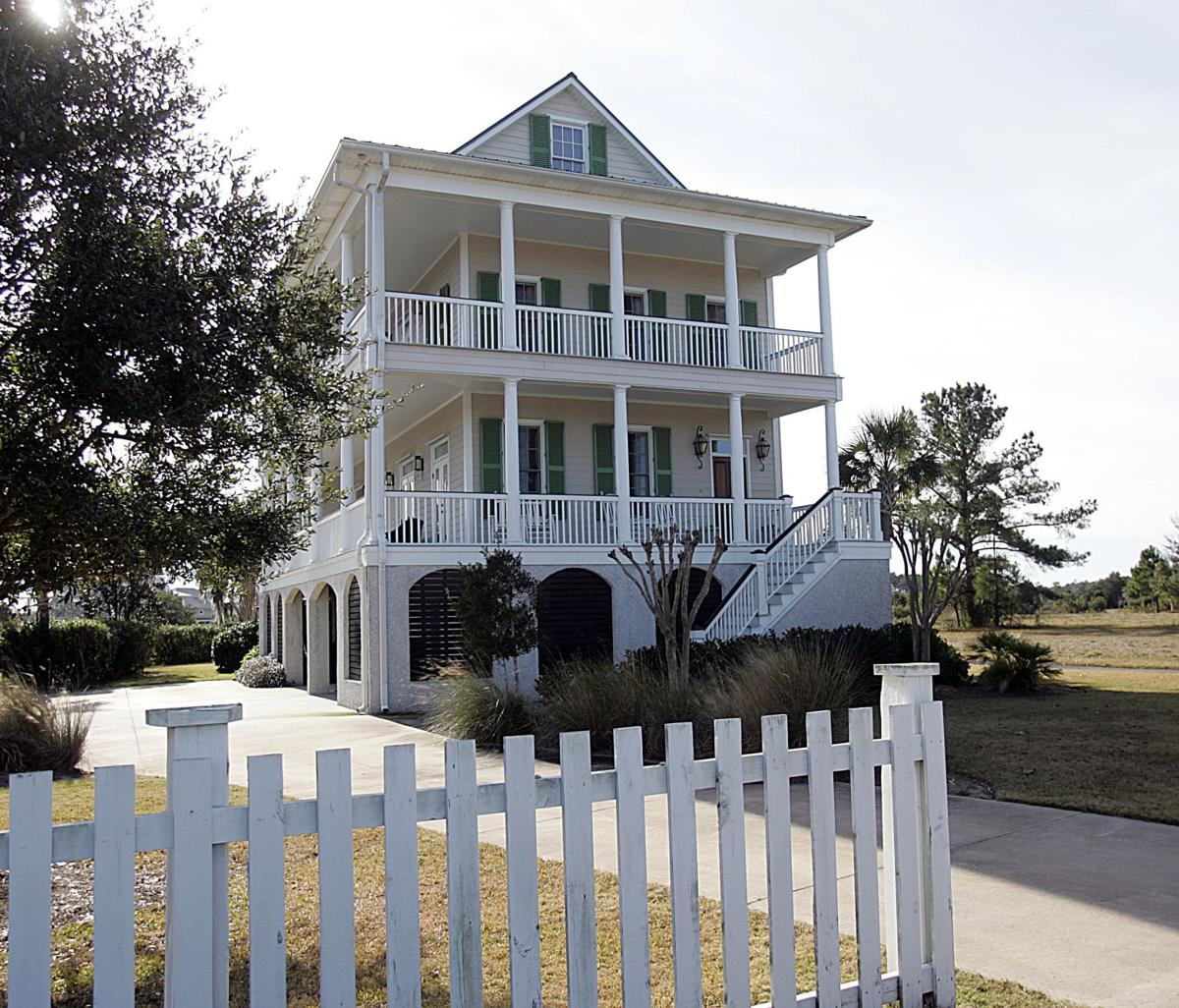 1202 Gregorie Commons -Traditional three-story home with modern appointments shows off panoramic views of Stono River
