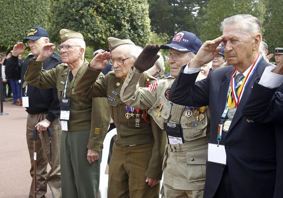 2 dozen U.S. veterans honor D-Day in France