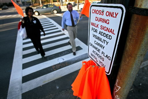 City offers orange flags to keep pedestrians safe