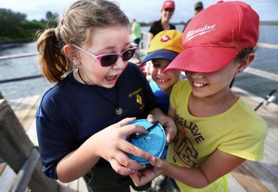 fishingworm girl cub scouts camp.jpg