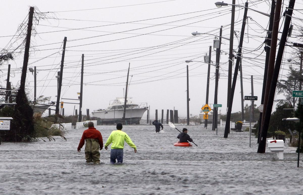Wrath of Sandy: 50 million in peril as superstorm slams into Northeast, brings 13-foot surge to New York City; at least 16 deadCrane dangles from NYC high-rise, clearing streetsSandy takes some of edge off AmericaMost of crew rescued after Bounty sinksHurricane Sandy latest twist in tight presidential campaign