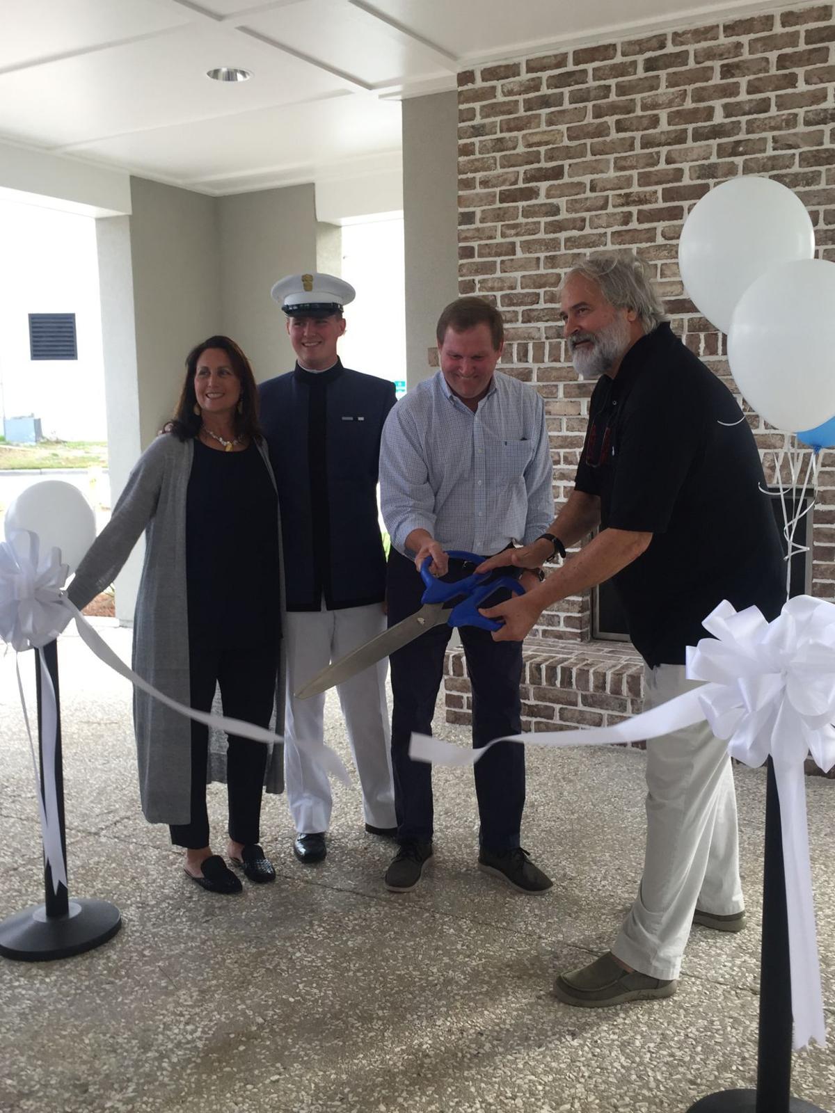 Debbie Swain, Connor Swain, Chris Swain, Rick McGeorge. Swain Boat pavilion ribbon cutting..jpg