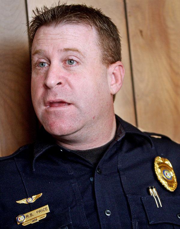Cottageville officer who shot former mayor laid off
