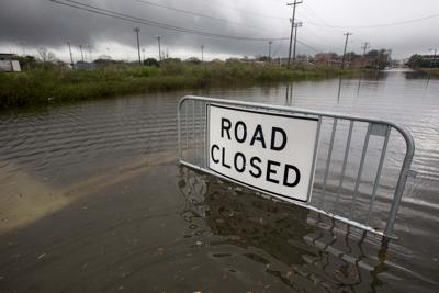 FLOOD ROAD CLOSED.