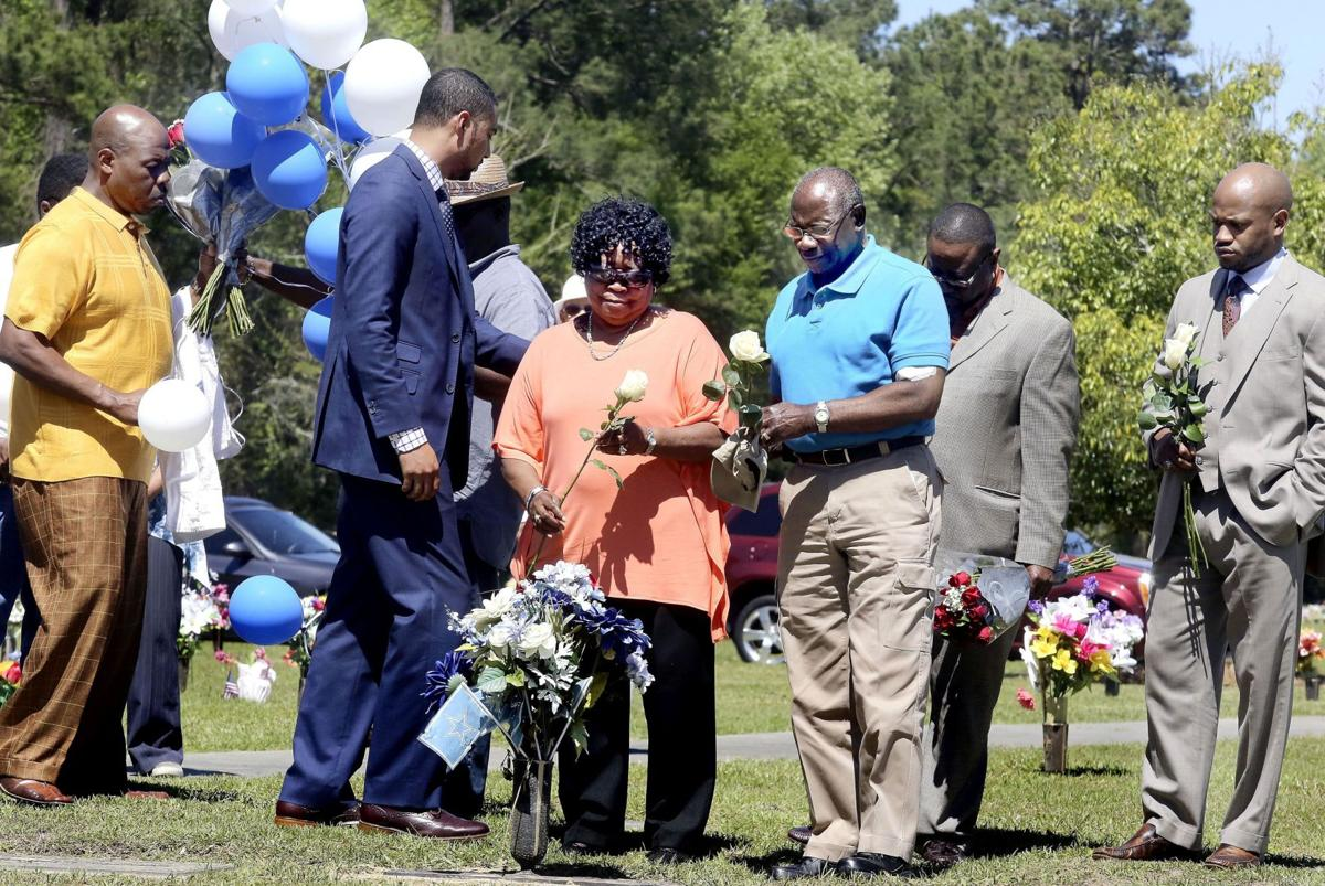 Never to be forgotten Family visits grave 1 year after Scott's death, urges meaningful reforms