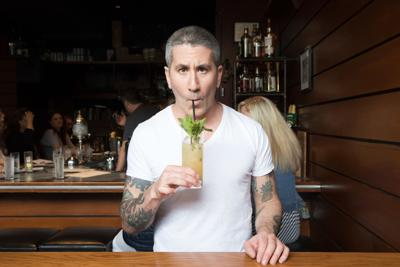 Chef Michael Solomonov sips a mocktail of his own making