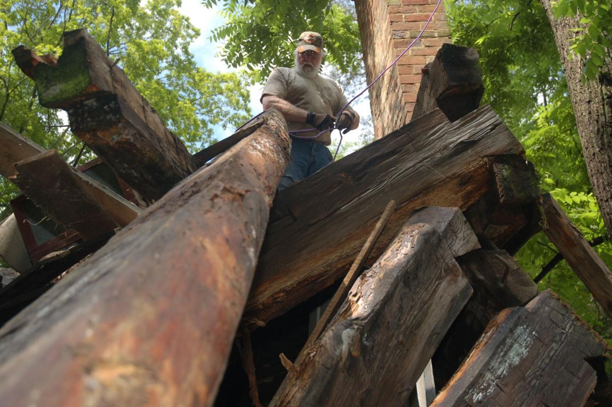 Restoring historic Tenn. cabins a family hobby