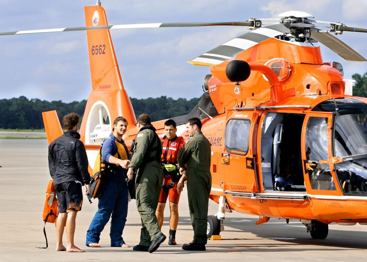 Four men rescued in storm-tossed sea Coast Guard copters pluck sailboat crew from waves