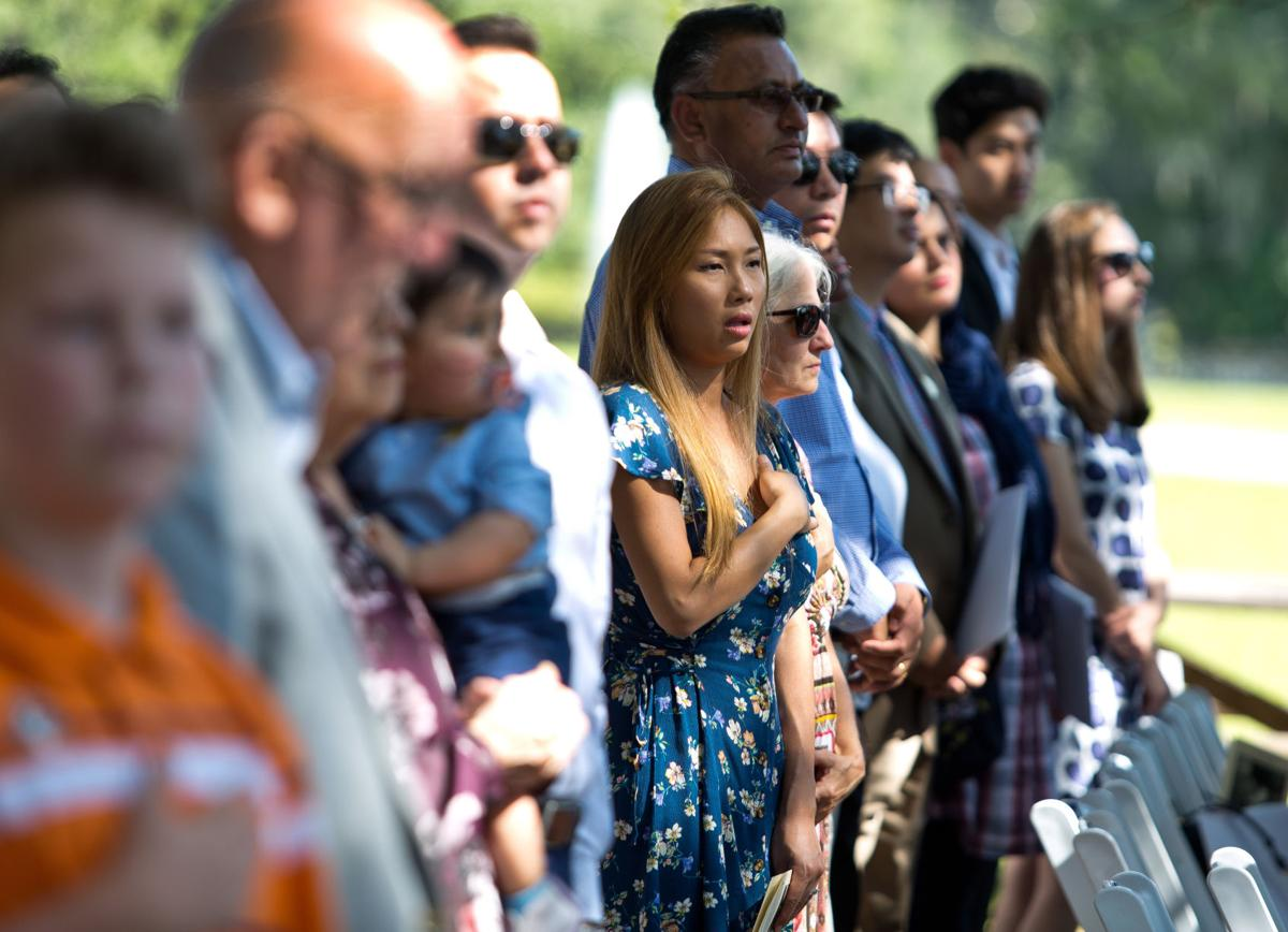 Photos: Sixty eight immigrants become citizens in ceremony at