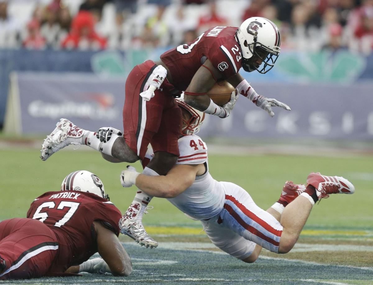 Shaw has fitting ending to career in Capital One Bowl victory over Wisconsin