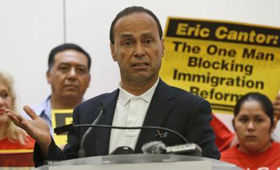 Hispanic congressman explains immigration order at N. Charleston church