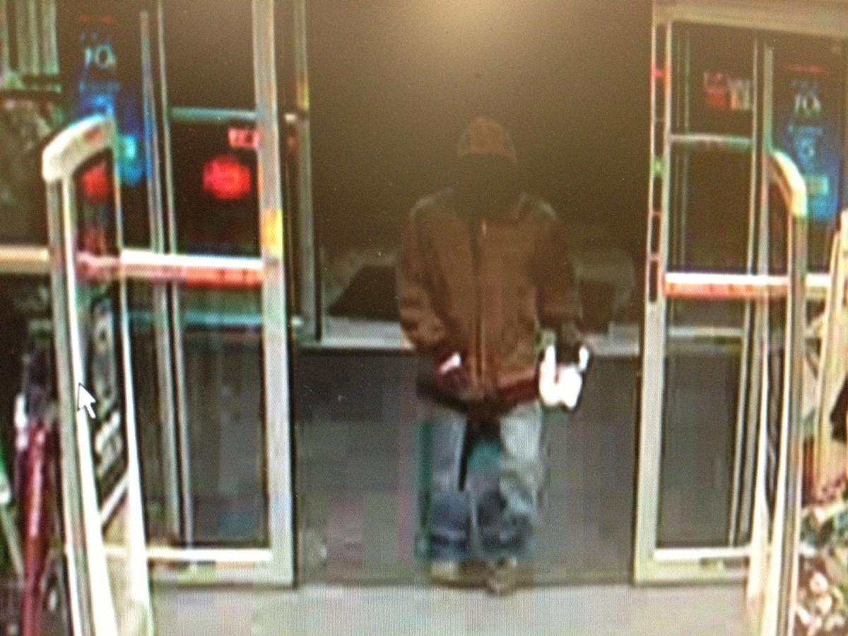 Police seek 2 men in robbery at CVS