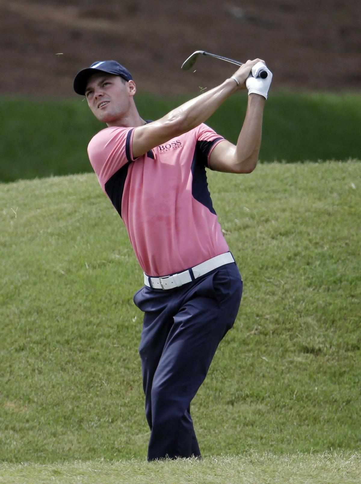 Kaymer holds on to win Players